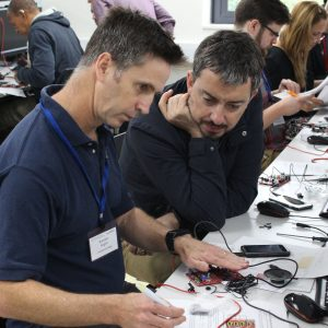 Two teachers looking at a circuit board